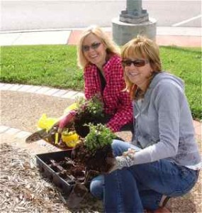 Viva Cuba member Tina and Kim plant the Garden.