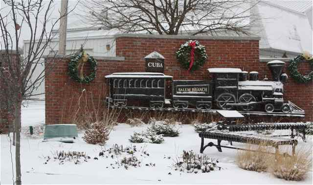 The 1873 replica train in the Viva Cuba Garden is decked out for Christmas.