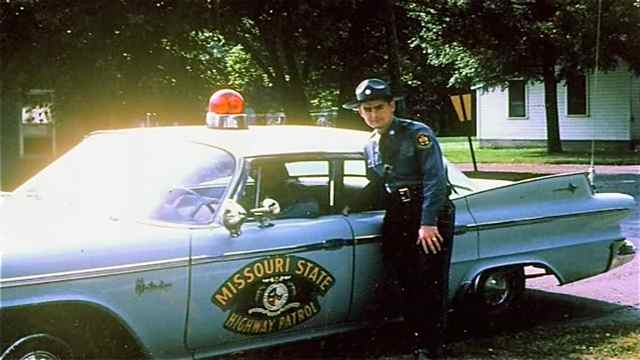 Aytes drove a patrol car similar to the one in the mural panel.