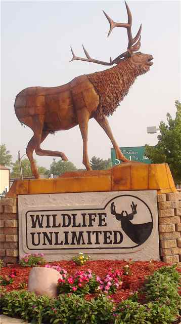 Glen Tutterrow sculpted the elk that stands proudly above his business sign.