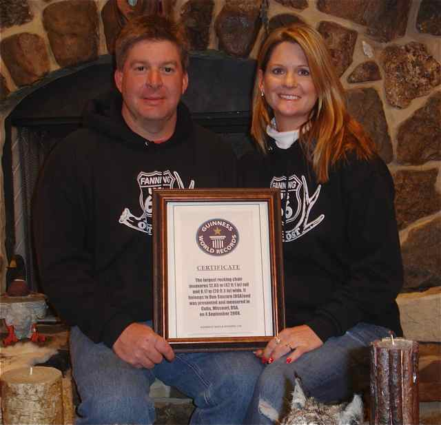Dan and Carolyn Sanazaro work hard at the General Store, Archery Range, and Taxidermy Shop. Here they hold their Guinness Certificate for the World's Largest Rocking Chair, an attraction that anchors the various businesses.