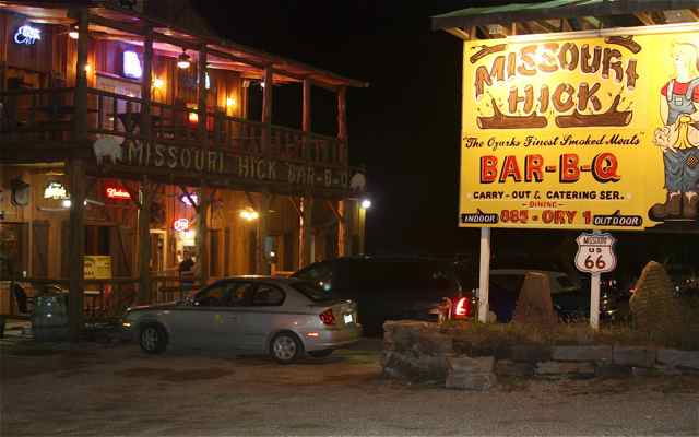 At night, Missouri Hick BBQ provides a bright stop along the road.