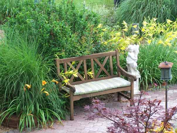 Here's an inviting spot for contemplation in the garden.