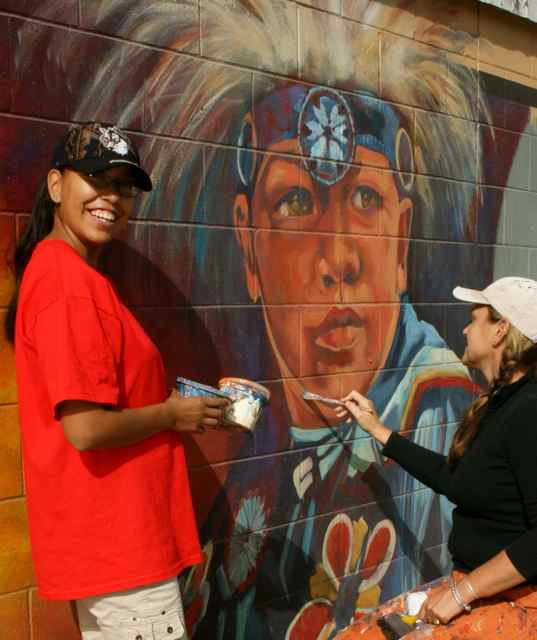 Michelle Loughery and her adopted daughter work on a heritage mural.