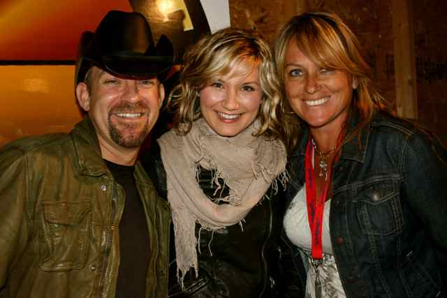Loughery(R) poses with with Country Western duo Sugarland.