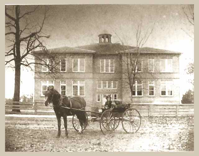 This was the original school that was later torn down. It sat in front of the present museum.