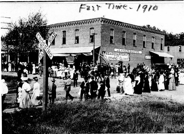 This old photo from 100 years ago shows that the community has always gathered to enjoy the fair parade.