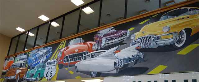 The vibrant car mural draws many appreciative looks from passersby and the truckers' section of the nearby restaurant.