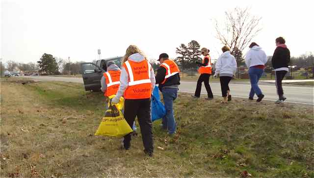 Cuba, MIssouri Volunteers in safety vest strike out along Route 66