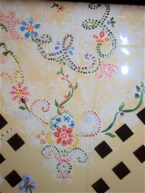 Floral details create a nostalgic garden glider.