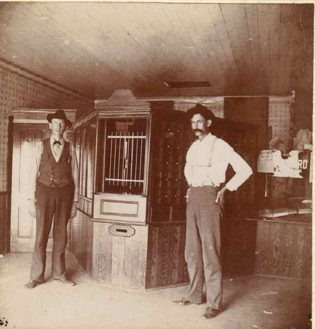 A.J. Barnett (L) with Mr. Munro at the bank.
