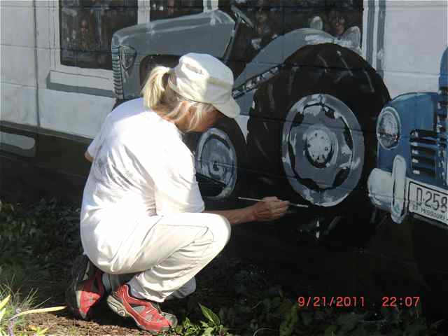 Leslie Faust repairs a tire in Cuba, Missouri