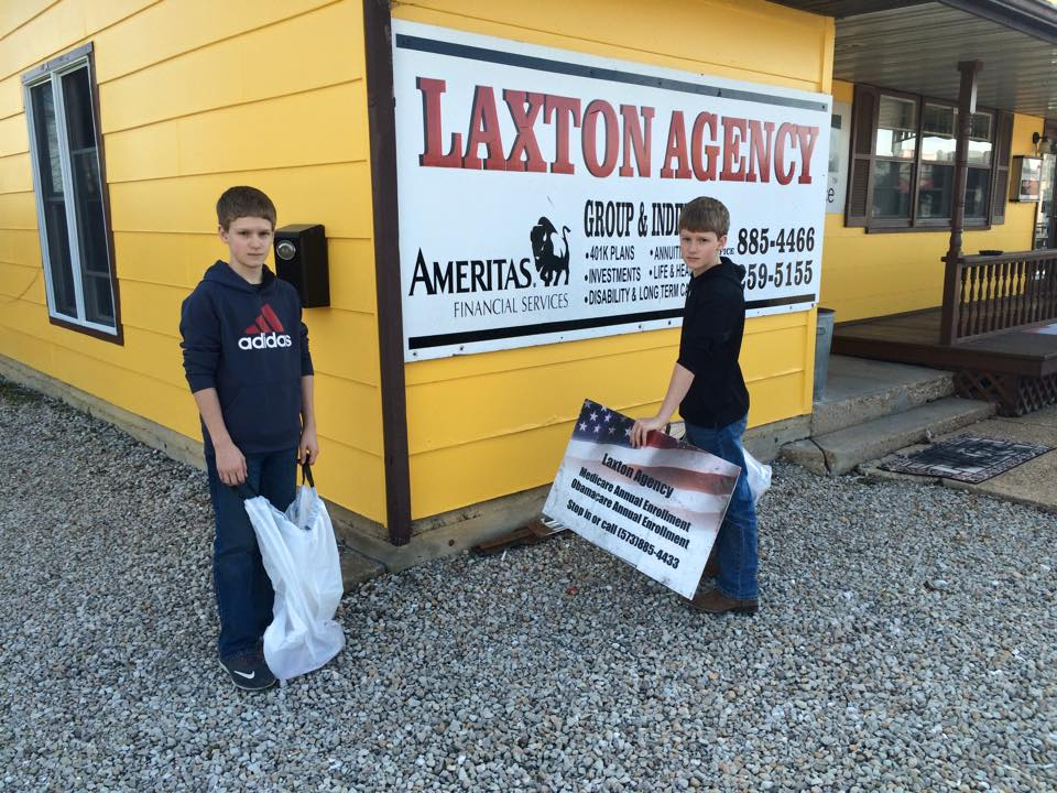 Alex and Nick Laxton pick up around their dad's Hwy. 19 insurance agency.