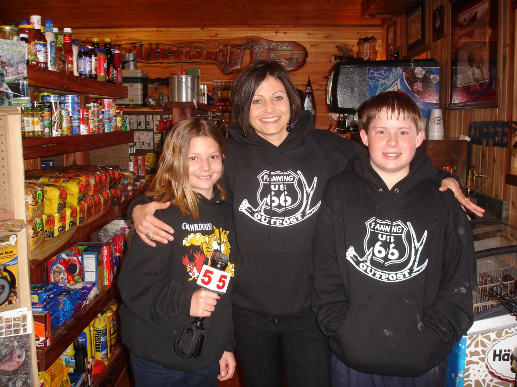 Heidi Glaus of KSDK St. Louis poses with the Sanazaro children on April 1, 2008, the day the 42'+ Rocking Chair took its place on Route 66.