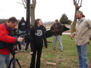 Heidi Glaus of Channel 5 KSDK St. Louis jokes with welder Joe Medwick on the day the rocker took its place on Route 66.